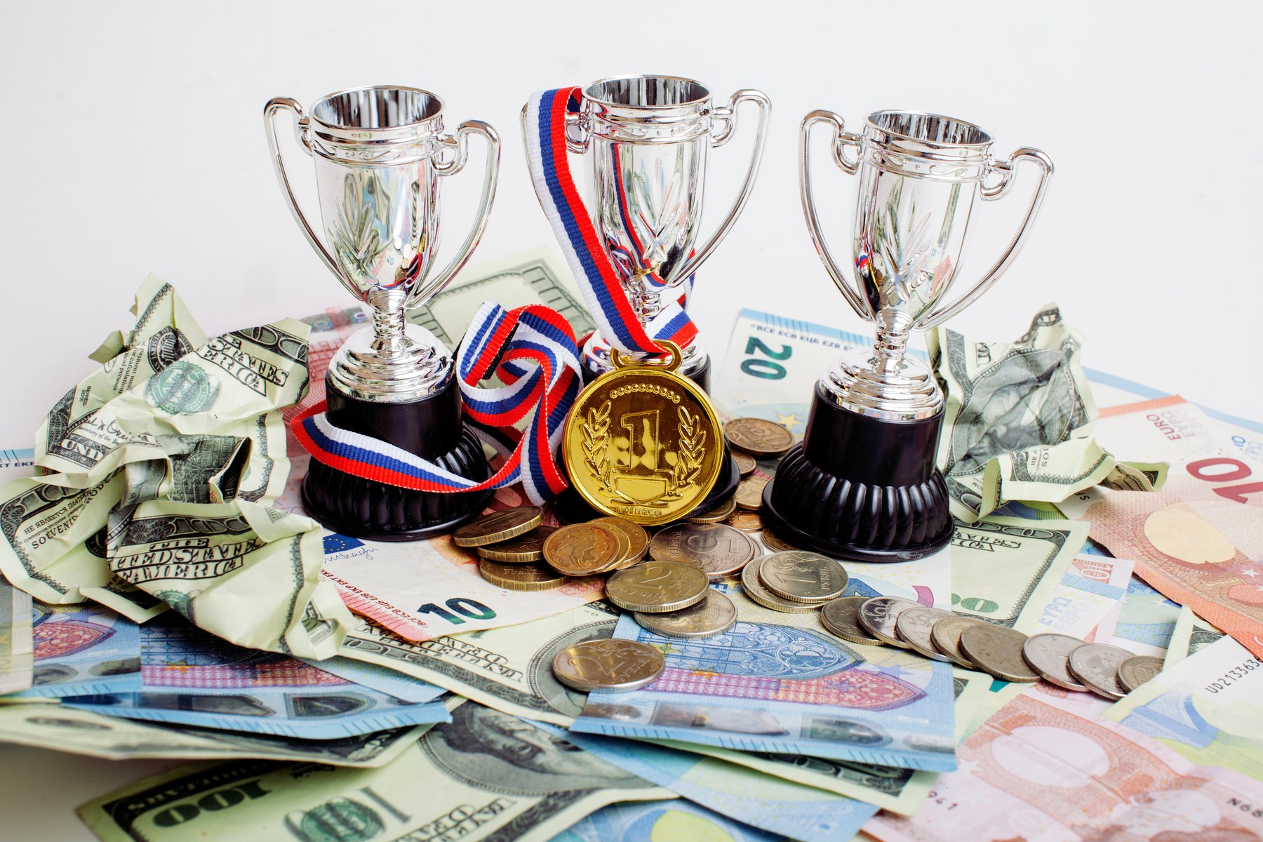 Sport winning concept: three cups among diverse currencies euro, dollar, rubl, gold medal first place close up, Image: 280999403, License: Royalty-free, Restrictions: , Model Release: no, Credit line: Profimedia, Alamy