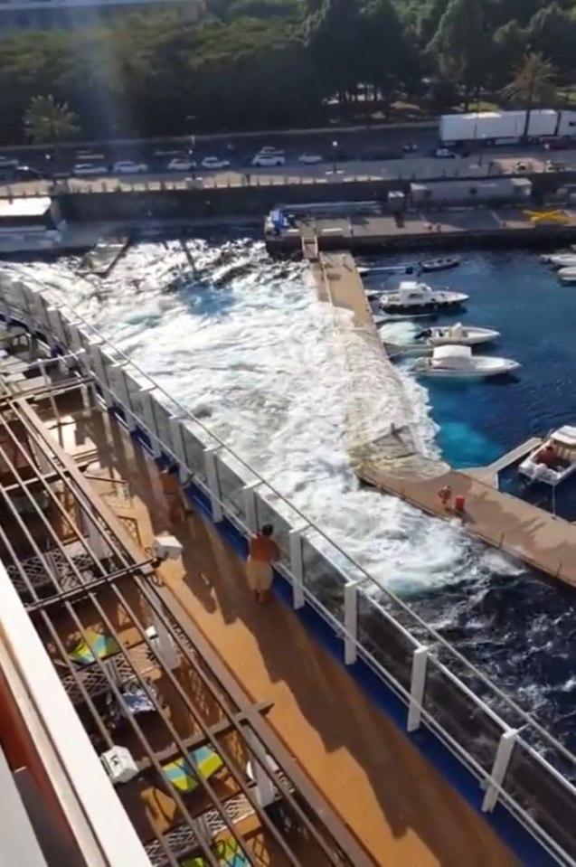 134,000-ton cruise liner floods marina after it causes a mini tsunami.