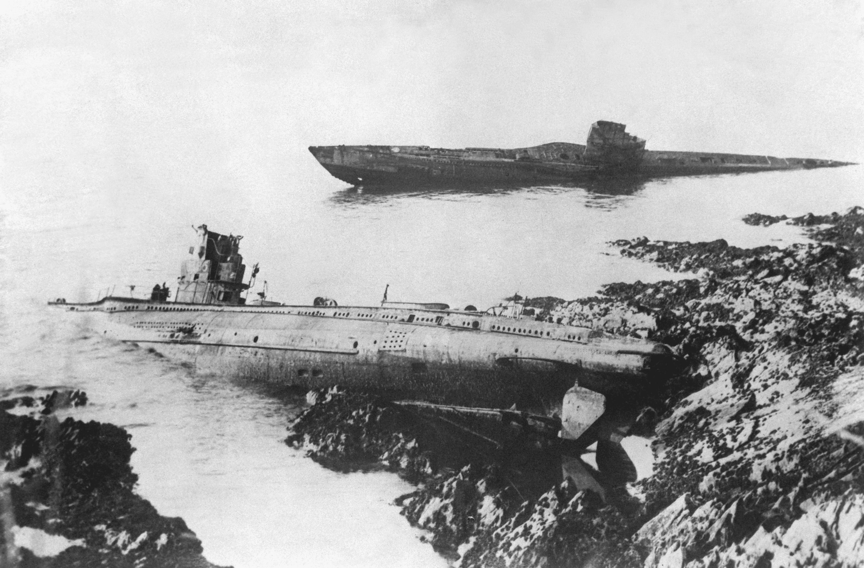 A most remarkable post-war incident was the washing up on the rocks at Falmouth, England, of two German U-boats. They were cast up but a few feet apart; both had been sunk during the war. 1921. INP. (OWI) Exact Date Shot Unknown NARA FILE #: 208-PR-10K-1 WAR & CONFLICT BOOK #: 709