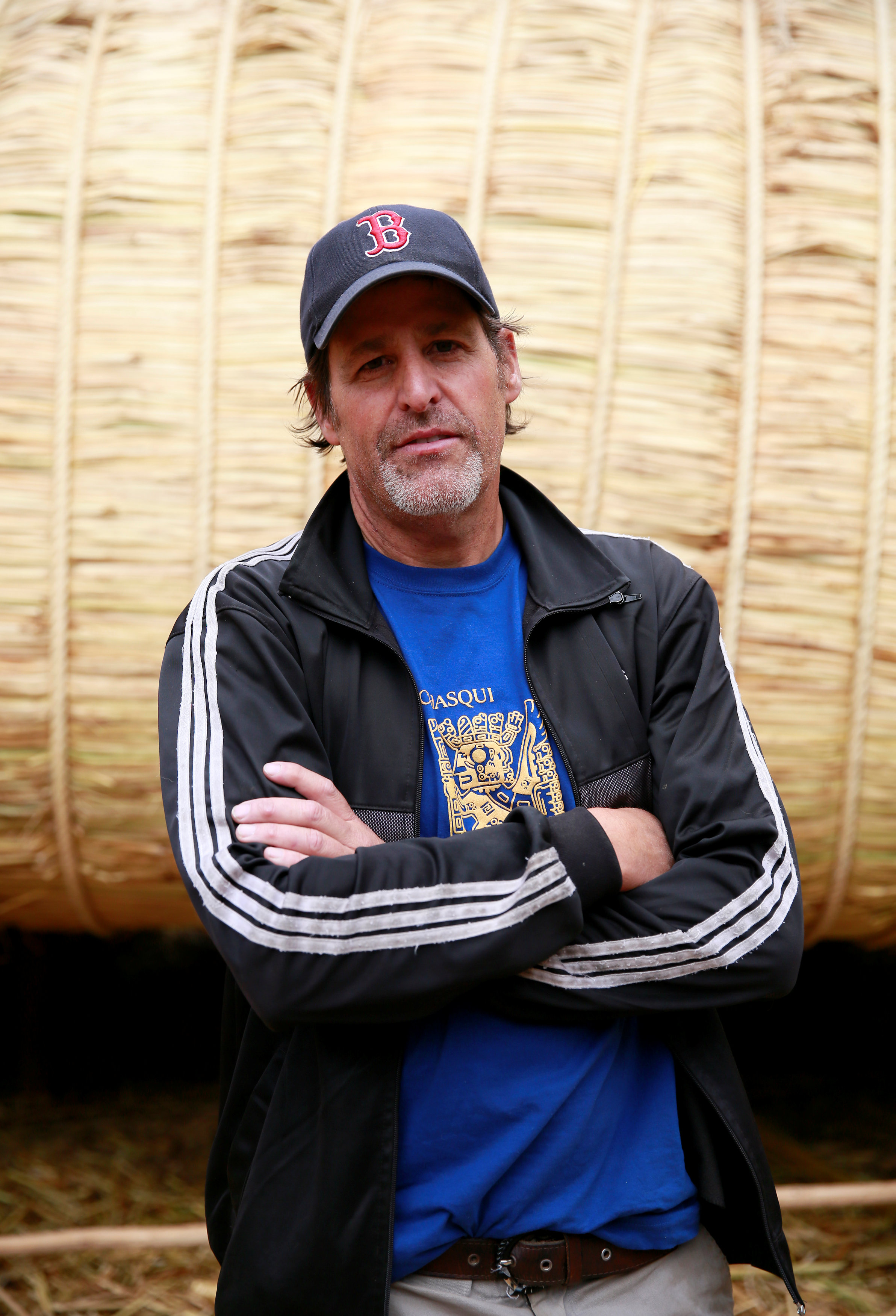 Phil Buck, a 51-year-old explorer from the United States, poses for a picture in front of the 'Viracocha III', a boat made only from the totora reed, which he will captain on a journey expected to last six months, crossing the Pacific from Chile to Australia, in La Paz, Bolivia, October 19, 2016. REUTERS/David Mercado